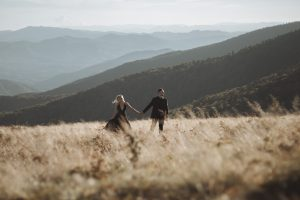 couple standing on a high mountain